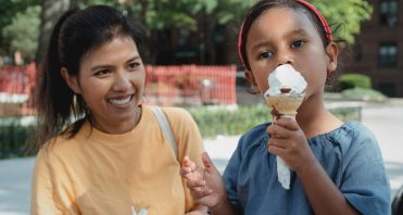 Mom and child outside with ice cream cone